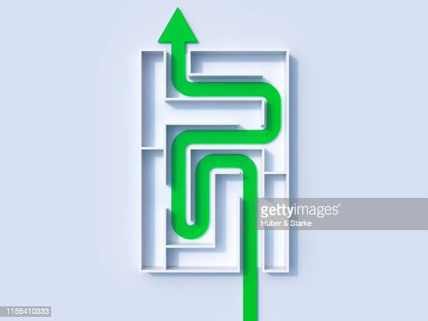 green line formed as an arrow in a maze
