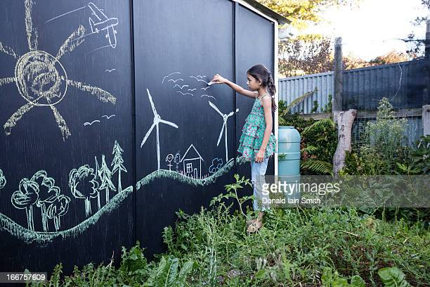 Green living on chalk board