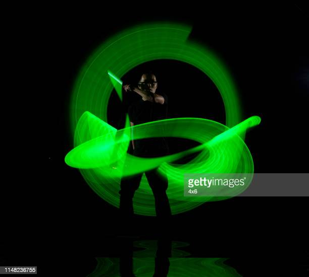 green long exposure lights - lightsaber stock pictures, royalty-free photos & images