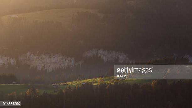green meadow and village on high hill view from Harder Kulm, Interlaken, Switzerland at sunset time