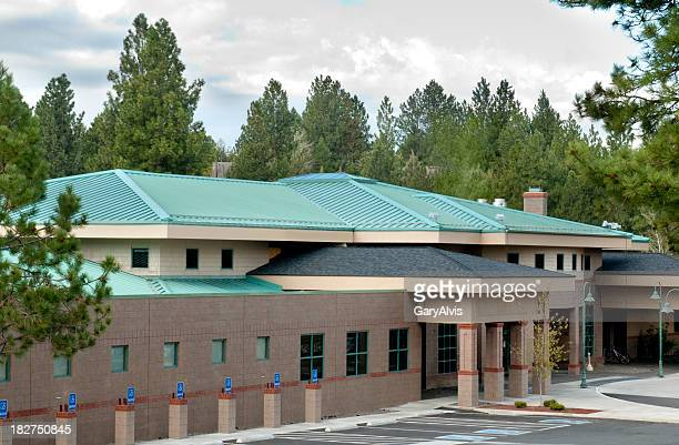 Green metal roofing w/building exterior