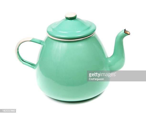 Green Metal teapot on white