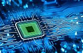 Green microchip set in a blue printed circuit board
