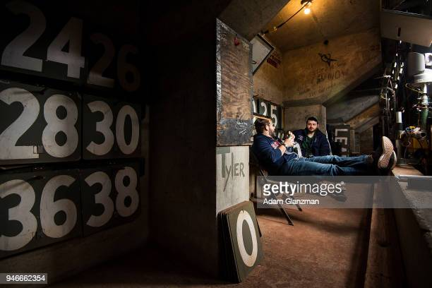 Green monster scoreboard operators Paul D'Angelo and Aaron Kanzer sit inside the scoreboard before a game between the Boston Red Sox and the...