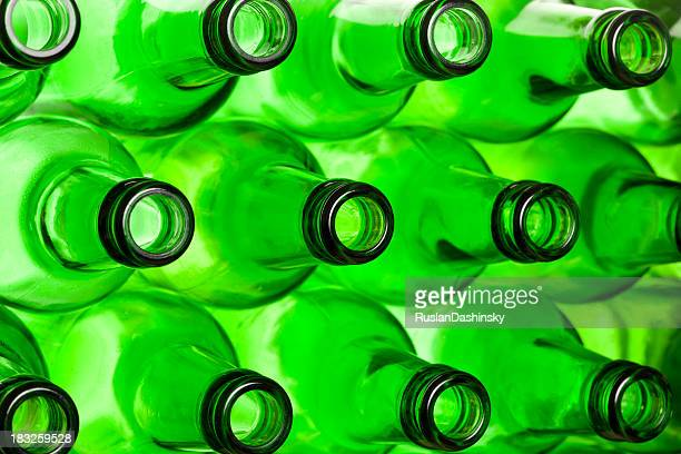 Green necks of beer bottles.