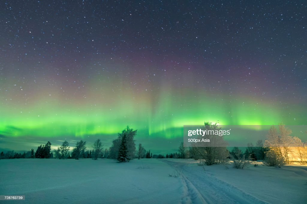 Green Northern Lights On Starry Night Sky Murmansk Russia Stock