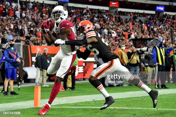 Green of the Arizona Cardinals catches a touchdown pass under pressure by Greedy Williams of the Cleveland Browns during the fourth quarter at...