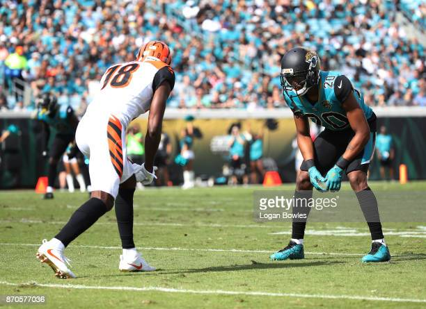 J Green of the Cincinnati Bengals and Jalen Ramsey of the Jacksonville Jaguars wait for a play in the first half of their game at EverBank Field on...