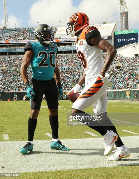 J Green of the Cincinnati Bengals and Jalen Ramsey of the Jacksonville Jaguars discuss a play in the first half of their game at EverBank Field on...