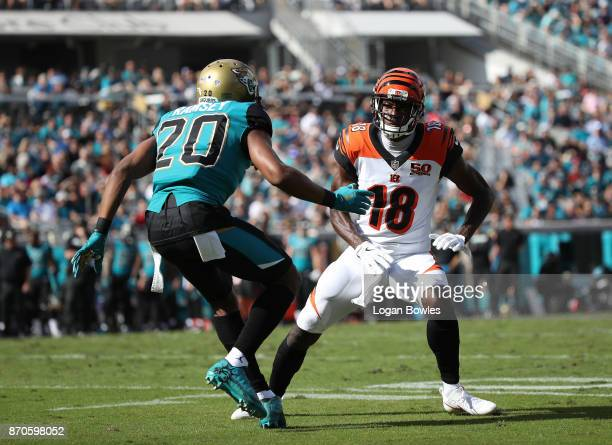 J Green of the Cincinnati Bengals and Jalen Ramsey of the Jacksonville Jaguars are seen on the field in the first half of their game at EverBank...