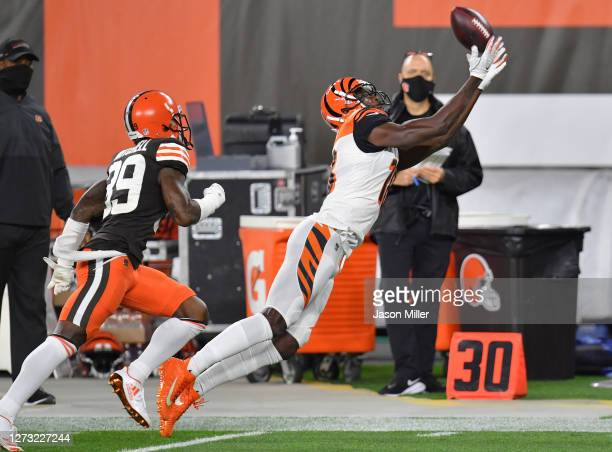 Green of the Cincinnati Bengals attempts a reception against Terrance Mitchell of the Cleveland Browns during the first quarter at FirstEnergy...