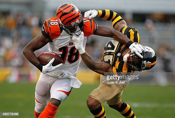J Green of the Cincinnati Bengals attempts to shed Antwon Blake of the Pittsburgh Steelers before both being called for facemask penalties in the 4th...