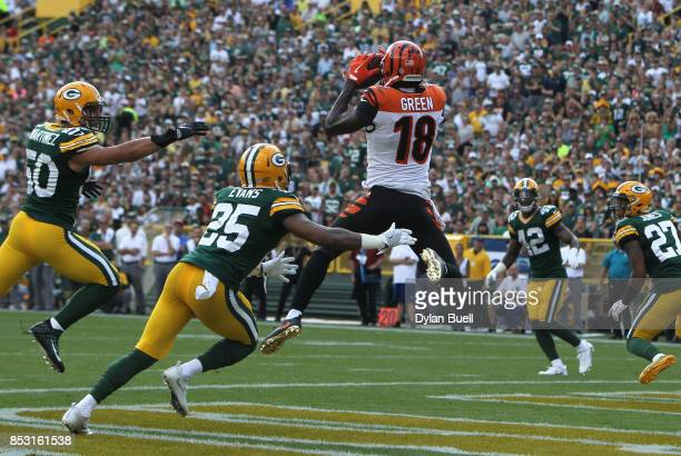 J Green of the Cincinnati Bengals catches a touchdown pass during the first quarter against the Green Bay Packers at Lambeau Field on September 24...