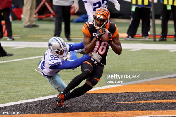 Green of the Cincinnati Bengals catches a touchdown pass while being guarded by Saivion Smith of the Dallas Cowboys in the second quarter at Paul...