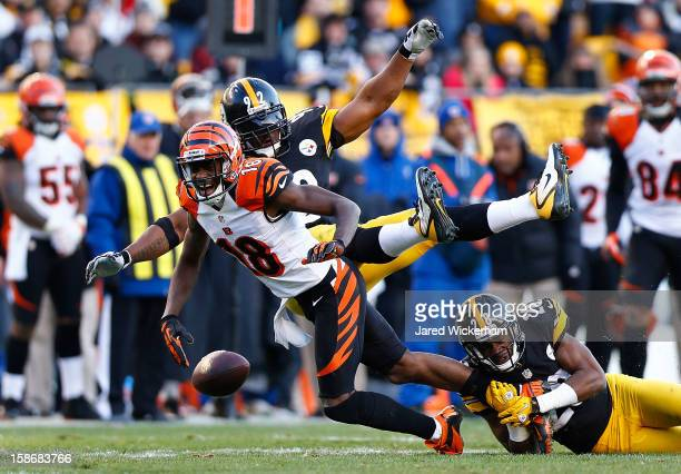 J Green of the Cincinnati Bengals fumbles the ball after having it knocked out of his hands by James Harrison of the Pittsburgh Steelers during the...