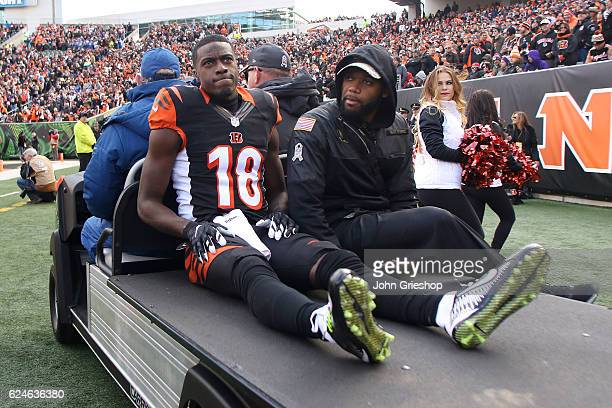 J Green of the Cincinnati Bengals gets carted off of the field after being injured during the first quarter of the game against the Buffalo Bills at...