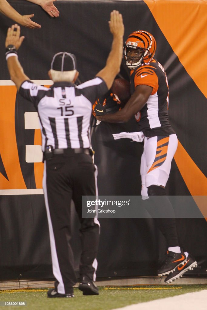 A.J. Green #18 of the Cincinnati Bengals hauls in a touchdown pass during the game against the Baltimore Ravens at Paul Brown Stadium on September 13, 2018 in Cincinnati, Ohio. The Bengals defeated the Ravens 34-23.