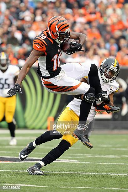 J Green of the Cincinnati Bengals is tackled by Will Allen of the Pittsburgh Steelers during the third quarter at Paul Brown Stadium on December 13...