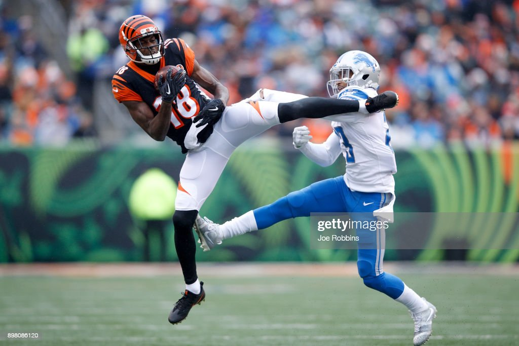 A.J. Green #18 of the Cincinnati Bengals makes a catch defended by Darius Slay #23 of the Detroit Lions during the first half at Paul Brown Stadium on December 24, 2017 in Cincinnati, Ohio.