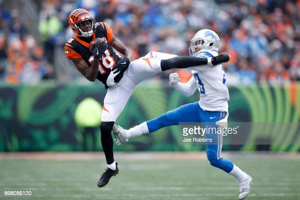 J Green of the Cincinnati Bengals makes a catch defended by Darius Slay of the Detroit Lions during the first half at Paul Brown Stadium on December...