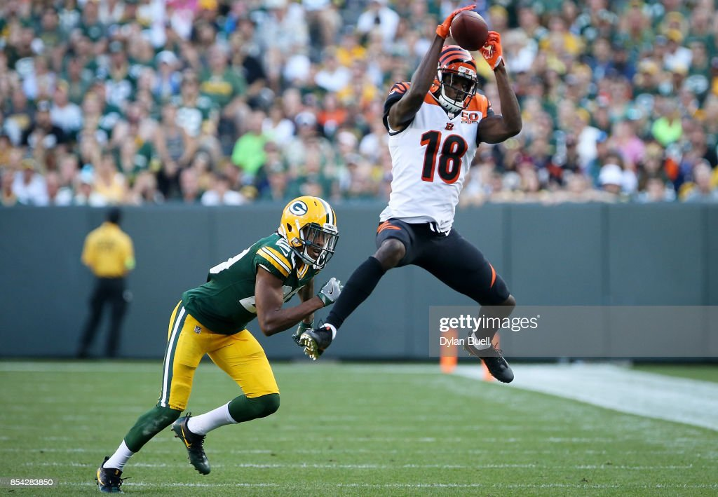 A.J. Green #18 of the Cincinnati Bengals makes a catch past Kevin King #20 of the Green Bay Packers in the fourth quarter at Lambeau Field on September 24, 2017 in Green Bay, Wisconsin.