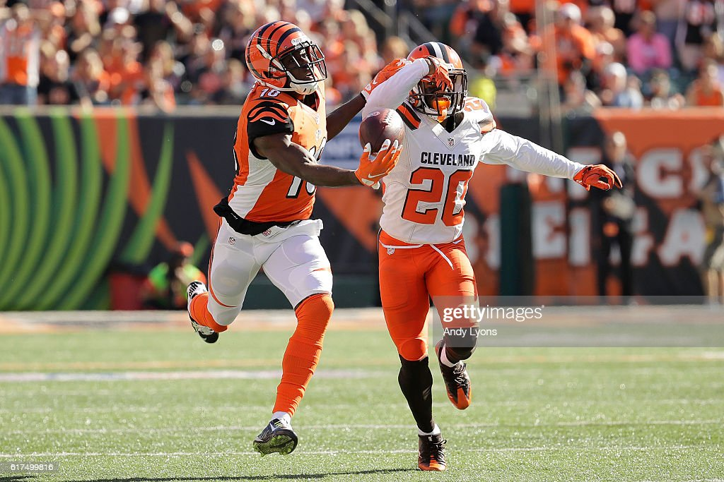 A.J. Green #18 of the Cincinnati Bengals makes a one handed catch while being defended by Briean Boddy-Calhoun #20 of the Cleveland Browns during the third quarter at Paul Brown Stadium on October 23, 2016 in Cincinnati, Ohio.