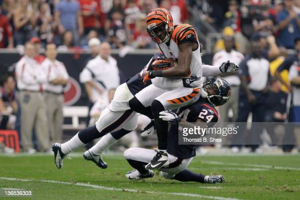 J Green of the Cincinnati Bengals makes a reception in the first half against Johnathan Joseph and Glover Quin of the Houston Texans during their...