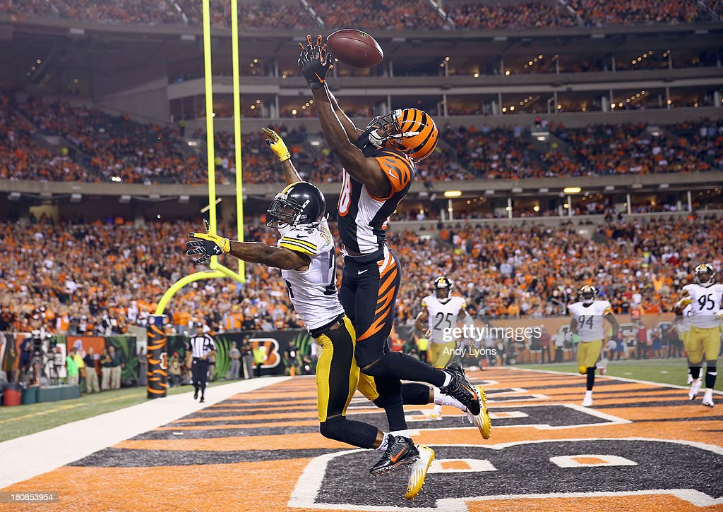 A.J. Green #18 of the Cincinnati Bengals reaches for a pass that would fall incomplete while being defended by Ike Taylor #24 of the Pittsburgh Steelers during the NFL game at Paul Brown Stadium on September 16, 2013 in Cincinnati, Ohio.