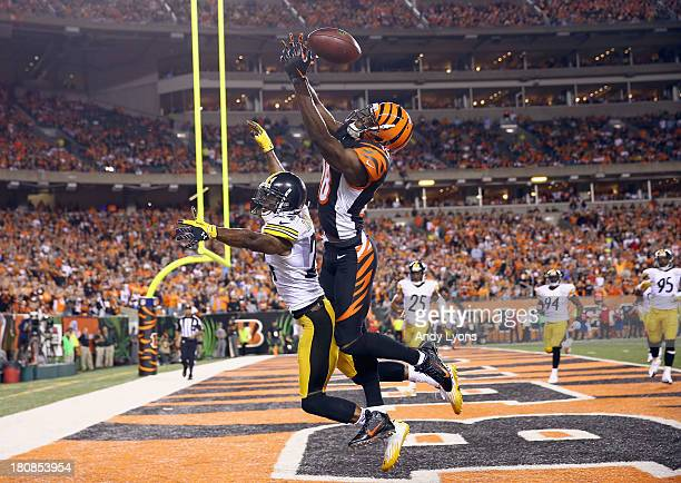 J Green of the Cincinnati Bengals reaches for a pass that would fall incomplete while being defended by Ike Taylor of the Pittsburgh Steelers during...