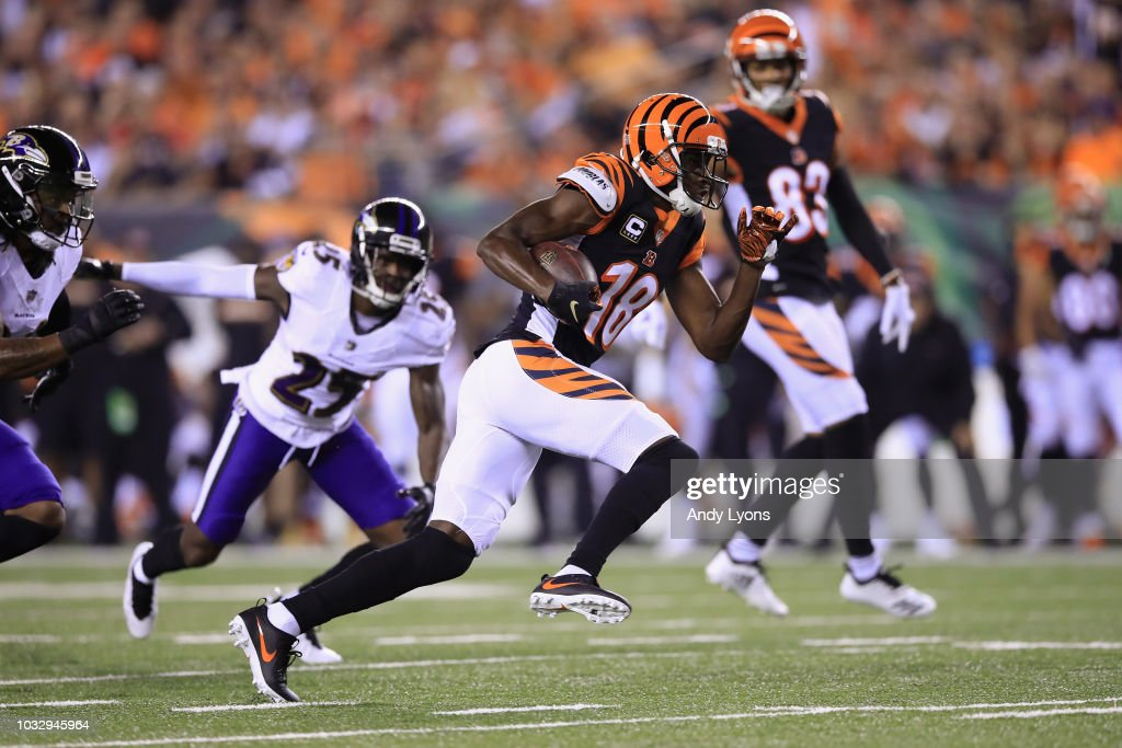 A.J. Green #18 of the Cincinnati Bengals runs on his way to scoring a 32-yard receiving touchdown during the first quarter against the Baltimore Ravens at Paul Brown Stadium on September 13, 2018 in Cincinnati, Ohio.