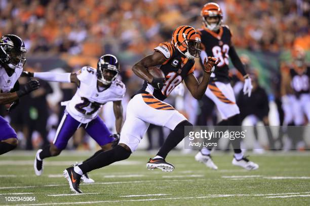 J Green of the Cincinnati Bengals runs on his way to scoring a 32yard receiving touchdown during the first quarter against the Baltimore Ravens at...