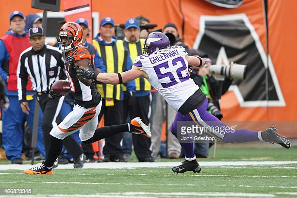 J Green of the Cincinnati Bengals runs the ball upfield against Chad Greenway of the Minnesota Vikings during their game at Paul Brown Stadium on...