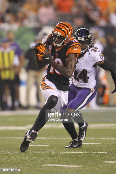 J Green of the Cincinnati Bengals runs the football upfield against Brandon Carr of the Baltimore Ravens during their game at Paul Brown Stadium on...