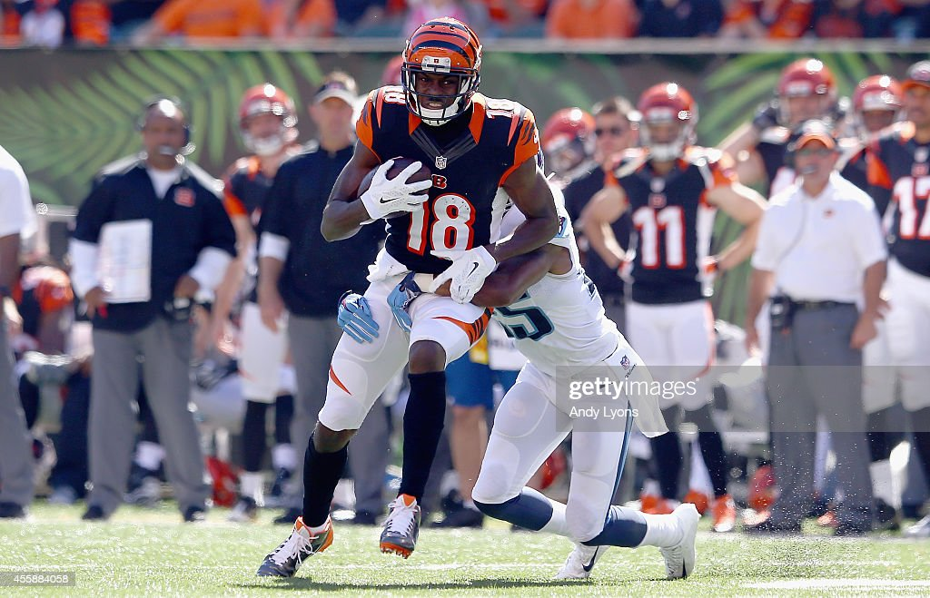 A.J. Green #18 of the Cincinnati Bengals runs with the ball during the game against the Tennessee Titans at Paul Brown Stadium on September 21, 2014 in Cincinnati, Ohio.