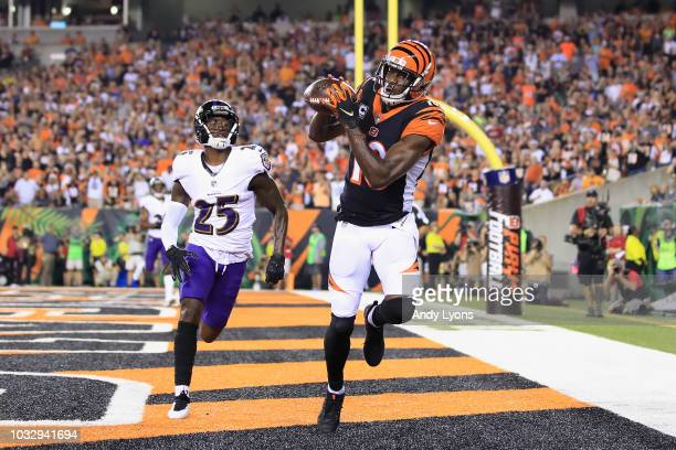 J Green of the Cincinnati Bengals scores a touchdown against Tavon Young of the Baltimore Ravens during the first quarter at Paul Brown Stadium on...