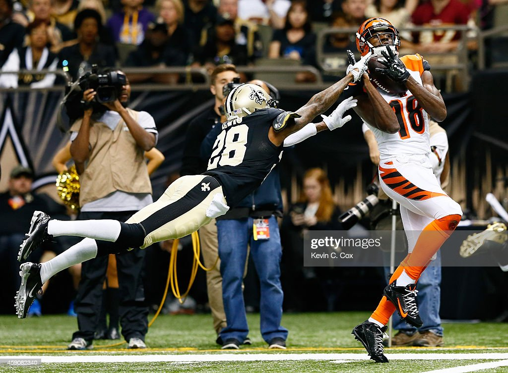 A.J. Green #18 of the Cincinnati Bengals with a touchdown reception against Keenan Lewis #28 of the New Orleans Saints during the second half at Mercedes-Benz Superdome on November 16, 2014 in New Orleans, Louisiana.
