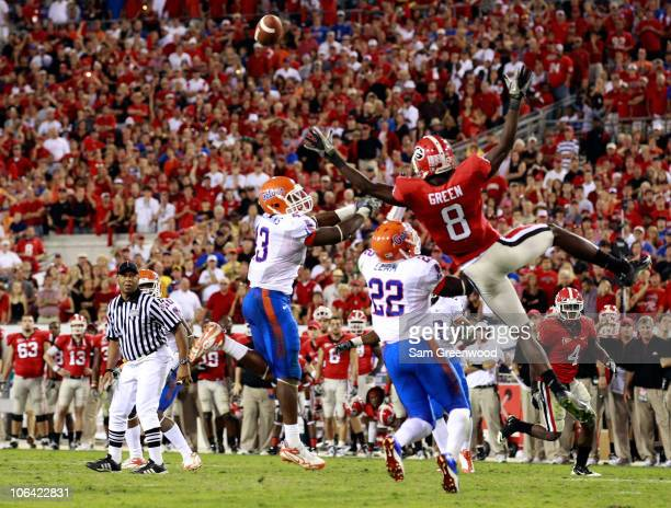 J Green of the Georgia Bulldogs attempts to catch a pass against Jelani Jenkins and Matt Elam of the Florida Gators during the game at EverBank Field...