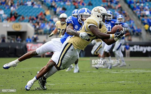 J Green of the Georgia Tech Yellow Jackets attempts to catch a pass as Derrick Baity of the Kentucky Wildcat defends during the game at EverBank...