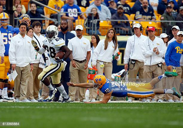 J Green of the Georgia Tech Yellow Jackets returns a kick 96 yards for a touchdown during the game against Chris Blewitt of the Pittsburgh Panthers...