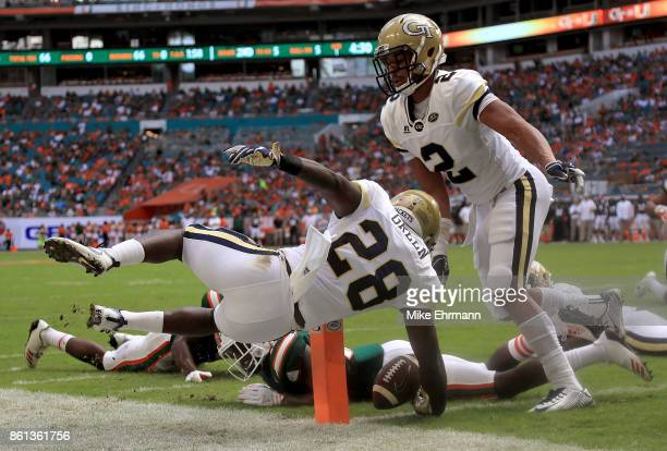 J Green of the Georgia Tech Yellow Jackets scores a touchdown during a game against the Miami Hurricanes at Sun Life Stadium on October 14 2017 in...