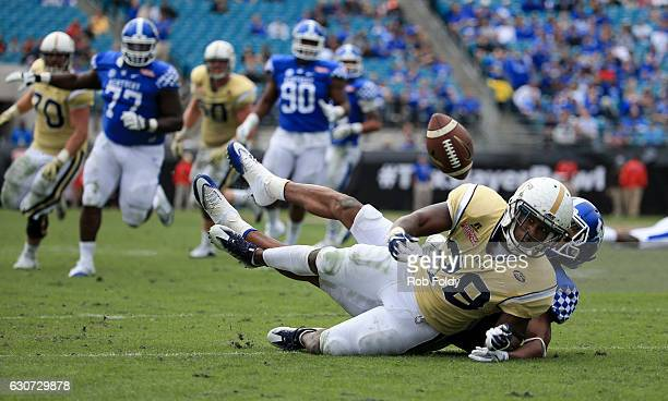 J Green of the Georgia Tech Yellow Jackets watches the ball get away as Derrick Baity of the Kentucky Wildcat defends during the game at EverBank...