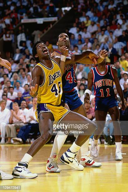 C Green of the Los Angeles Lakers boxes out against Adrian Dantley of the Detroit Pistons circa 1987 at the Great Western Forum in Inglewood...