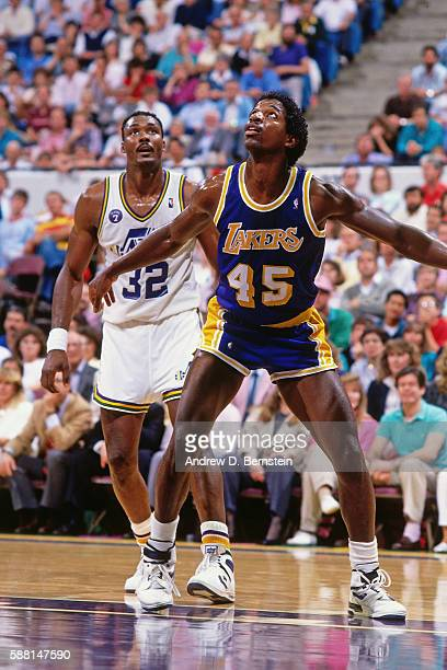 C Green of the Los Angeles Lakers boxes out Karl Malone of the Utah Jazz during a game in the 1988 Western Conference Semifinals at the Salt Palace...