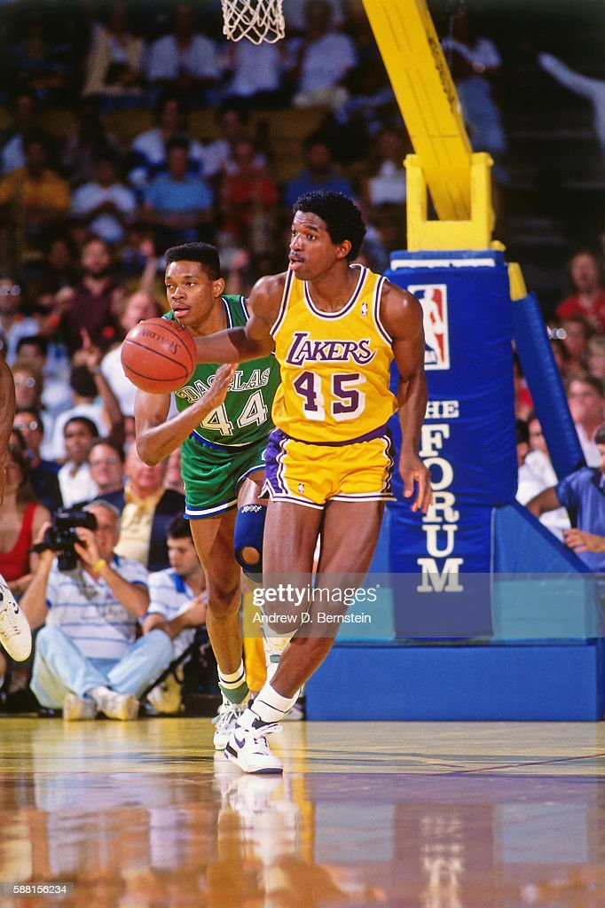 A C Green Of The Los Angeles Lakers Dribbles The Ball
