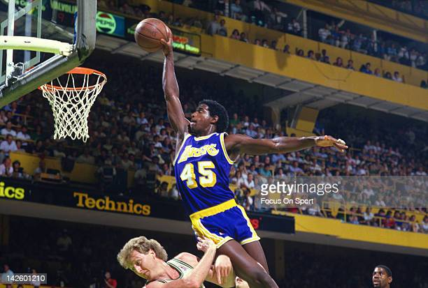 C Green of the Los Angeles Lakers jams the ball over Larry Bird of the Boston Celtics during the 1987 NBA Basketball Finals at the Boston Garden in...