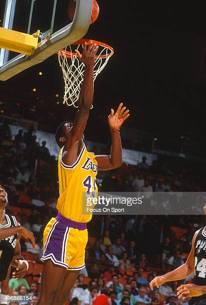 Green of the Los Angeles Lakers shoots against the San Antonio Spurs during an NBA basketball game circa 1990 at the Forum in Los Angeles,...
