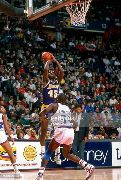 C Green of the Los Angeles Lakers shoots over Terry Catledge of the Washington Bullets during an NBA basketball game circa 1986 at the Capital Centre...