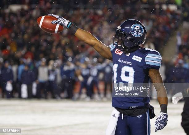 J Green of the Toronto Argonauts reaches forward with the ball to indicate first down after a catch against the Calgary Stampeders during the second...