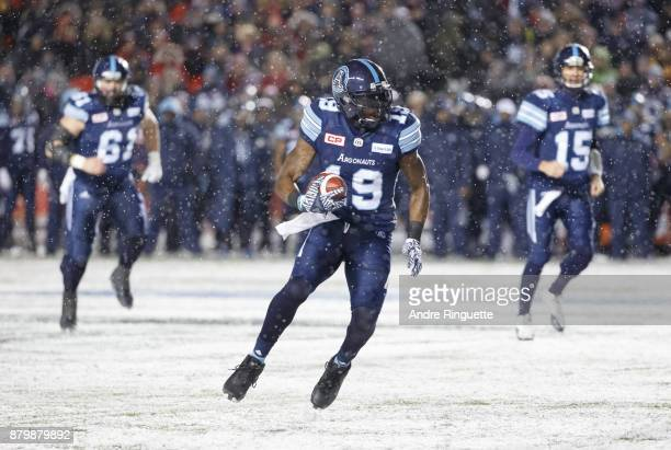 J Green of the Toronto Argonauts runs with the ball after a catch against the Calgary Stampeders during the second half of the 105th Grey Cup...
