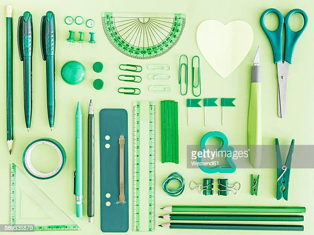 green office supplies on green background - neat stock pictures, royalty-free photos & images